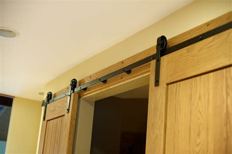 hanging doors on tracks barn door hardware sliding barn door hardware lowes