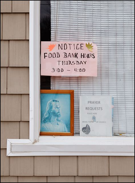 Lake In The Food Pantry by Faded Portrait Of Jesus In The Window Of Wolf Lake Food
