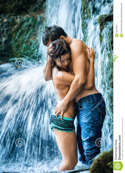 bedroom romance porn couple hugging and kissing under waterfall stock image
