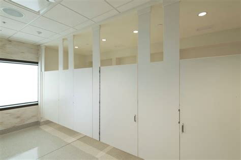 corian partitions columbus airport restroom design creates