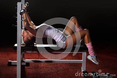 bench press for girls girl in gym bar bench press royalty free stock photo