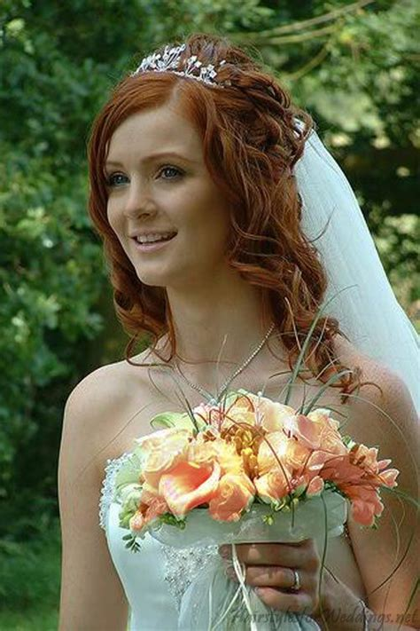 bridal hairstyles for red hair lots of loose curls with tiara and veil red hair