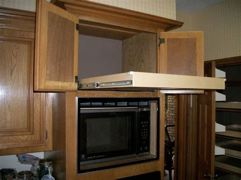 Above Microwave Cabinet by Single Height Glide Out Shelf Above A Microwave Kitchen