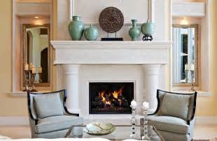 sleek living room with fireplace and grey chair designs