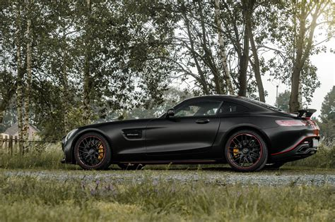 black and pink mercedes satin black mercedes amg gt s with dragon red stripes