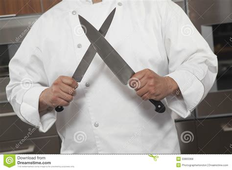 chef knife sharpening chef sharpening knives in commercial kitchen royalty free