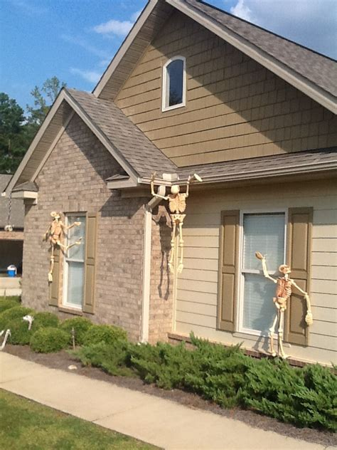 skeletons climbing house skeletons climbing the house halloween fun pinterest