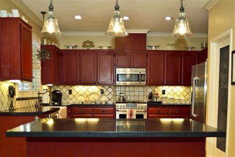 spanish tile kitchen backsplash cottage kitchen red cabinets spanish tile backsplash