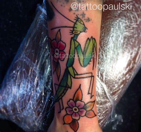 the golden rule tattoo traditional style praying mantis by paulski at the