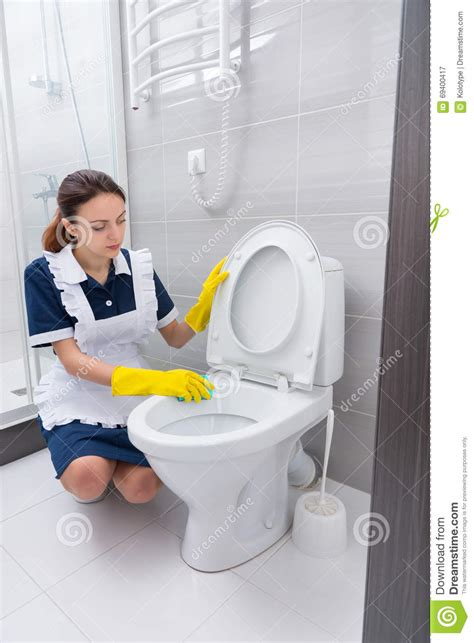 maid in bathroom maid cleaning toilet edge stock image image of interior