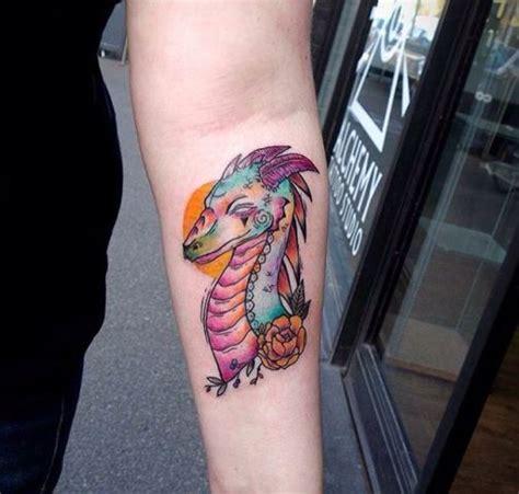 cartoon tattoo forearm picture of cartoon dragon tattoo on the forearm