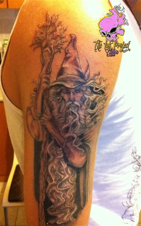 white wizard tattoo colorful wizard on half sleeve