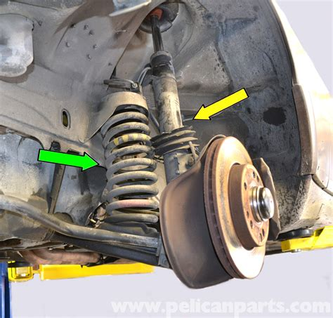 how to install replace front strut spring shock 2000 05 mercedes benz 190e front strut and spring replacement w201 1987 1993 pelican parts diy