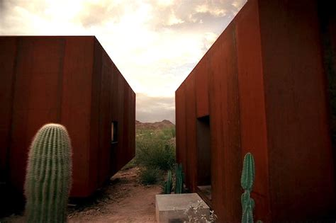 desert nomad house arizona s rusted steel desert nomad house is surrounded by towering saguaro cacti desert nomad