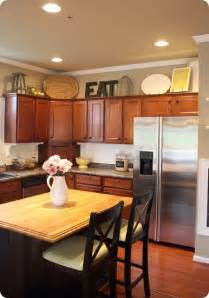 decorating above kitchen cabinets ideas how to decorate your kitchen cabinets sunlit spaces