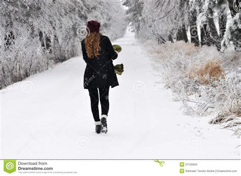 walking in a winter woman walking in winter forest royalty free stock photo image 37105655