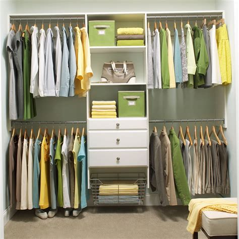 white home depot closet organizer with hanging clothes and
