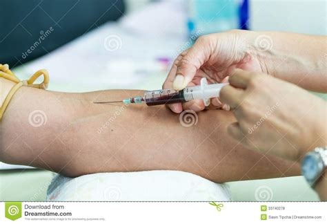 Drawing Blood by Doctor Drawing Blood Sle Royalty Free Stock Photos
