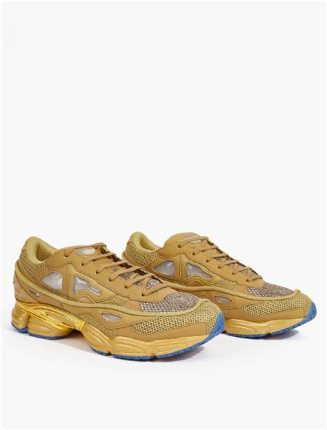 buy raf simons sneakers adidas by raf simons yellow ozweego 2 sneakers in khaki