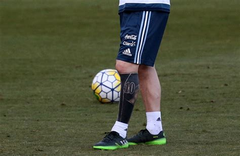 controversy erupts over lionel messi s love live tattoo image gallery messi tattoo