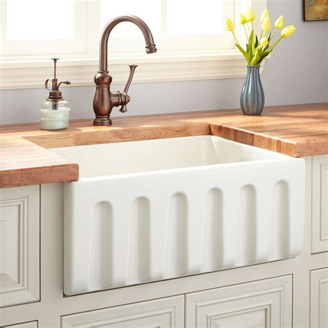 Fireclay Kitchen Sinks 24 quot fireclay reversible farmhouse sink fluted