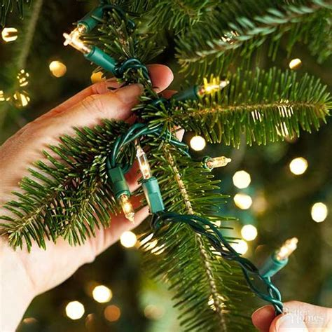 how to string lights on tree branches how to put lights on a tree better homes gardens