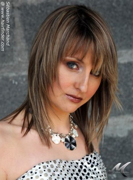 feathered haircuts for faces medium feathered hairstyles