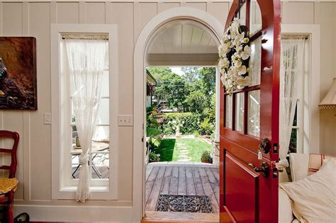 curtains on arched doorway arched doorway curtains hall rustic with wood floor wood
