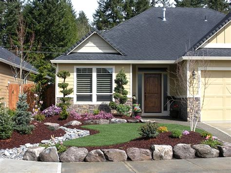 front yard landscaping ideas for small ranch house design with white gravels rocks small green