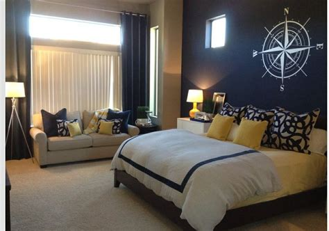 nautical bedroom theme navy blue accent wall yellow accents master bedroom