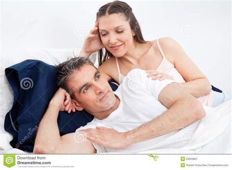 how to seduce your husband in bed man in bed turning away from woman stock image image