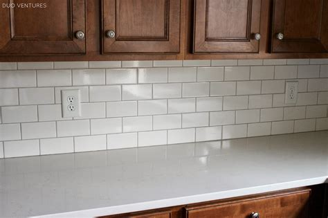 duo ventures kitchen update grouting caulking subway tile backsplash