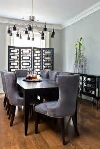 stylish dining room with black wooden table grey chairs