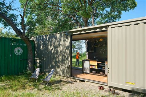 Dwell Studio Lighting off grid shipping container cabin has a warm wooden
