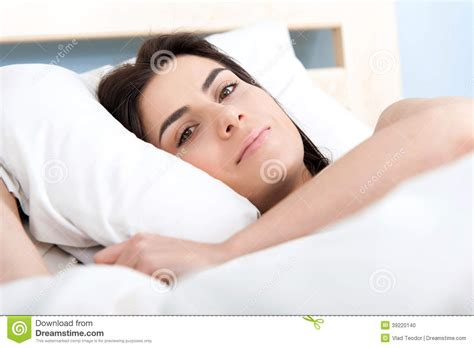 lying in my bed beautiful young woman lying in bed stock photo image