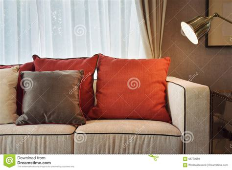 brown sofa with red cushions brown and red pillow on sofa with l in living room