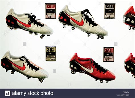soccer plus gear custom apparel soccer goods nike football boots on display in sporting goods shop uk