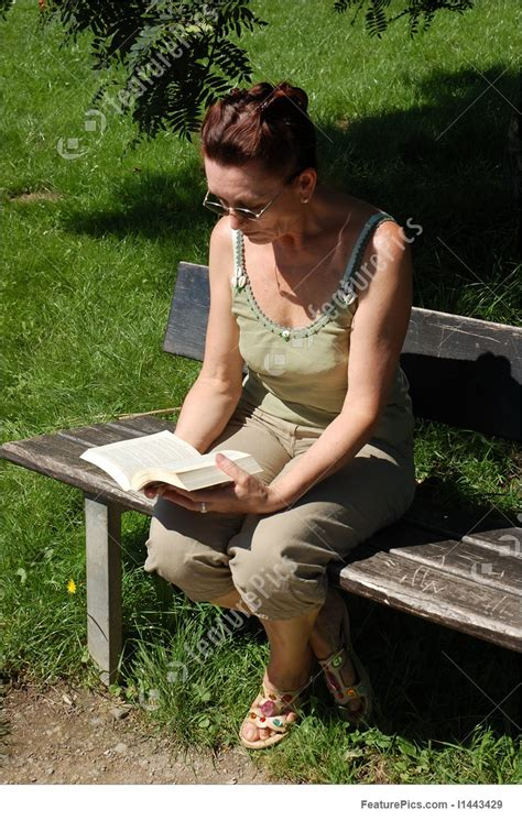 women bench woman reading on a park bench stock picture i1443429 at