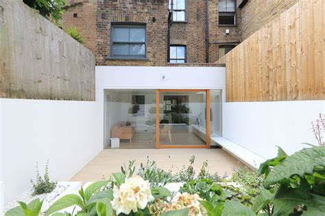 Dining Room House Extension A Bright White Dining Room Extension And Terraced Garden