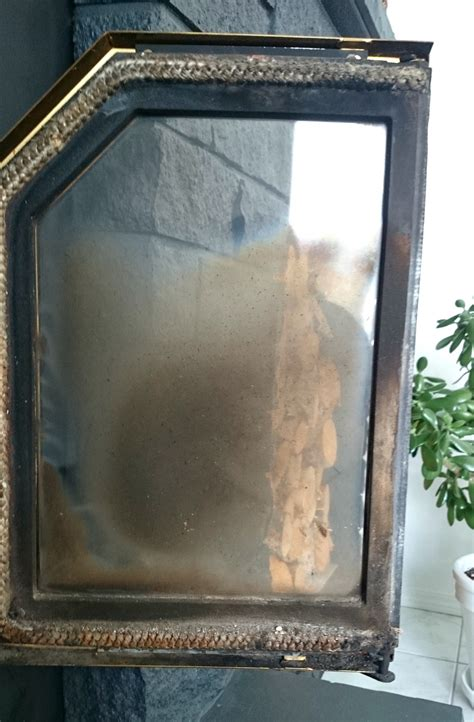 how to clean glass fireplace doors easily dans le