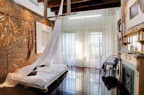 high curtains industrial loft style bedroom design with high ceiling and