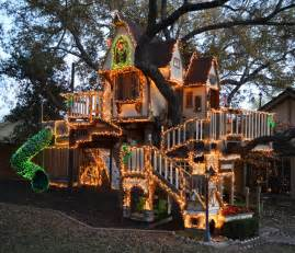 a magical tree house lights up for christmas eclectic