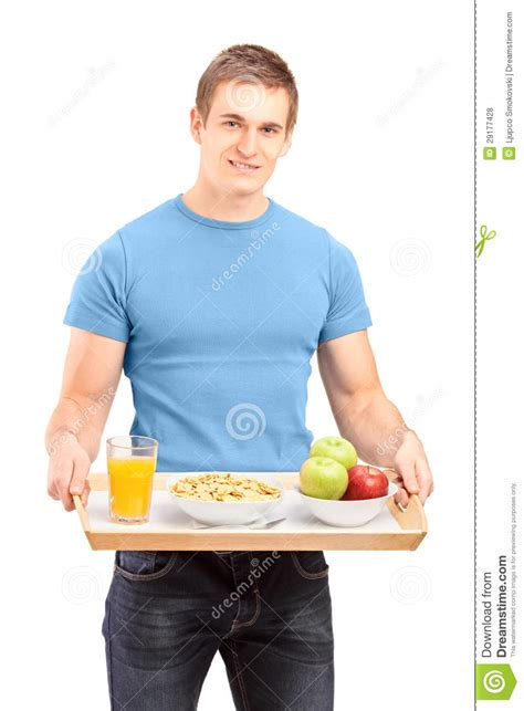 carrying food a smiling carrying a wooden tray with drinks and food stock photo image 29177428