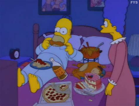 homer in bed the 20 best gifs of homer simpson stuffing his face first we feast