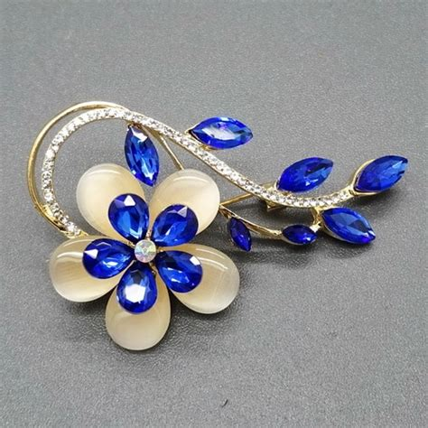 Bros Bross Murah Jilbab Aksesoris Bunga Logam Silver grosir bros bunga mata kucing daun blue sapphire