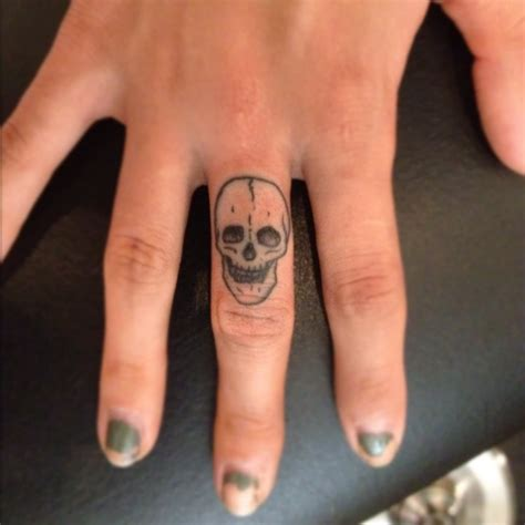 skull tattoo on finger manly skull finger for