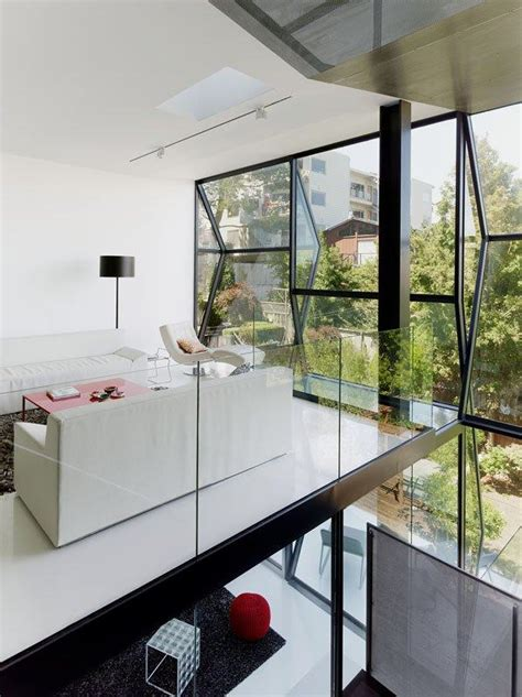 striking house featuring faceted glass wall facade flip