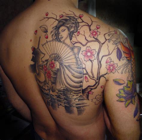tattoo geisha schiena tribal tiger tattoo archivio fotografico tattoo