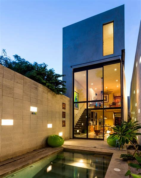 skinny concrete home  double height glass doors