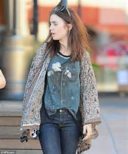 dressing for the occasion lily collins looks bohemian in